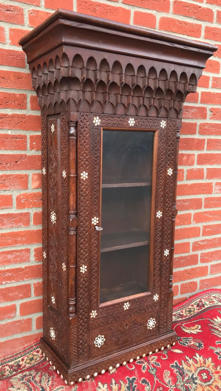 Stylish Antique Eastern Style Wooden Wall Hanging Cabinet with Intricate Details For Sale 12