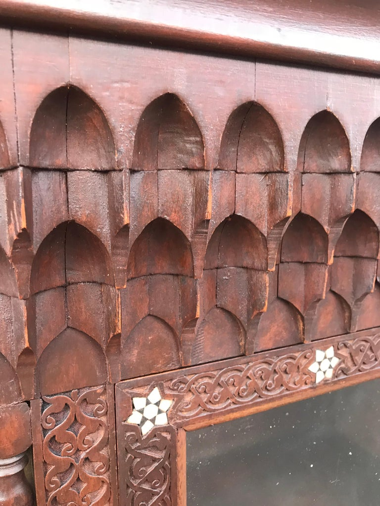 Hand-Crafted Stylish Antique Eastern Style Wooden Wall Hanging Cabinet with Intricate Details For Sale