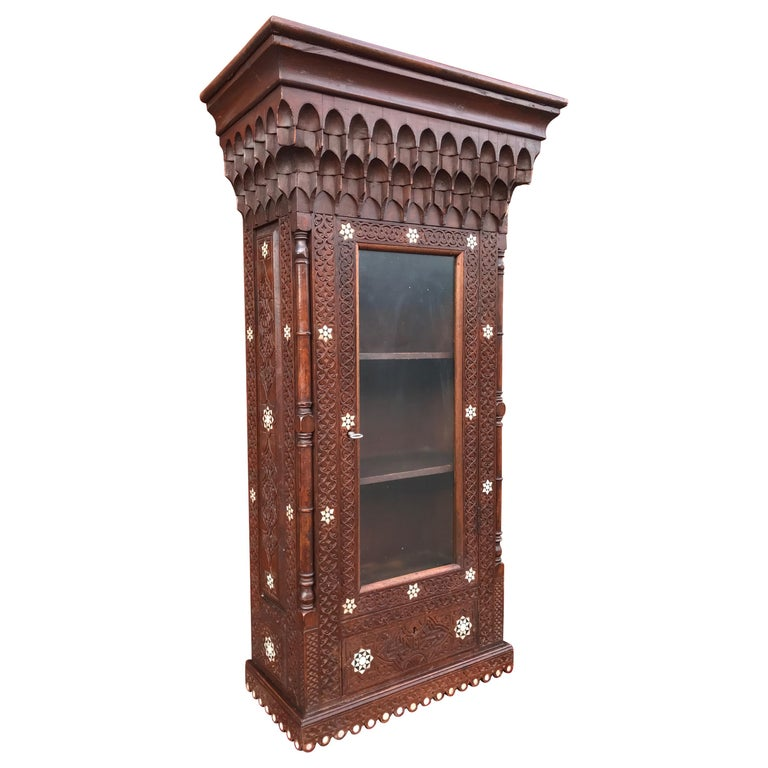 Stylish Antique Eastern Style Wooden Wall Hanging Cabinet with Intricate Details For Sale