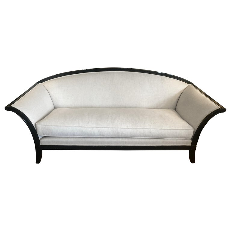 Stylish Curvy Backed Black Laquer Sofa with Linen Upholstery For Sale