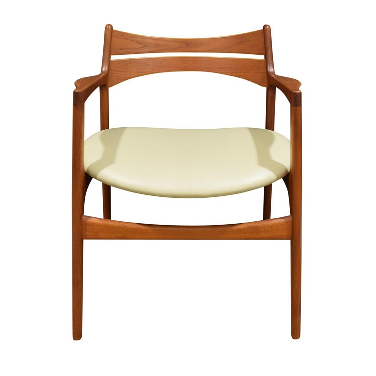 Stylish desk chair in teak with ladder back and seat reupholstered in vinyl, Denmark 1950's (stamped