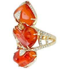 Stylish Fire Opal Ring with Diamonds and Sapphire Set in 18 Karat Gold