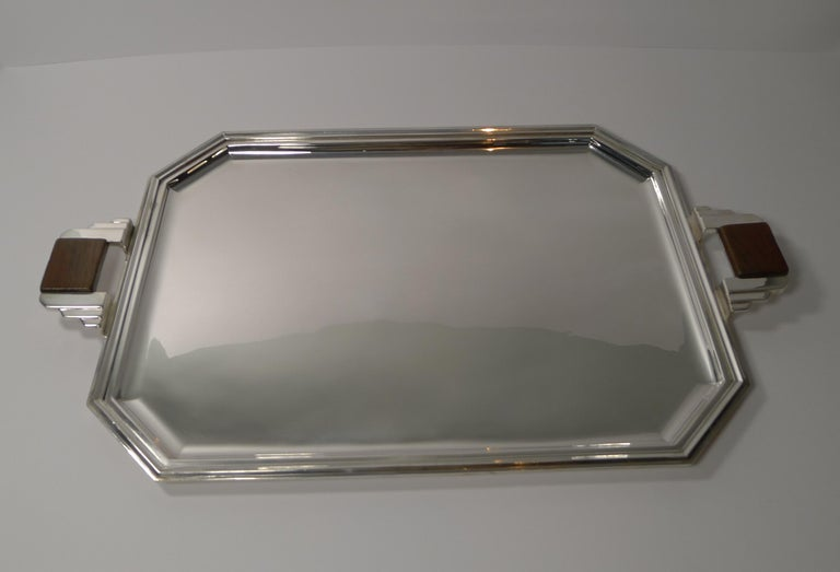 A fabulous French silver plated tray, beautiful Art Deco in style and era dating to circa 1930/1940.  Both of the handles are inset with a wooden (Walnut) handle with a quality screwed construction.  The underside is fully marked as per the