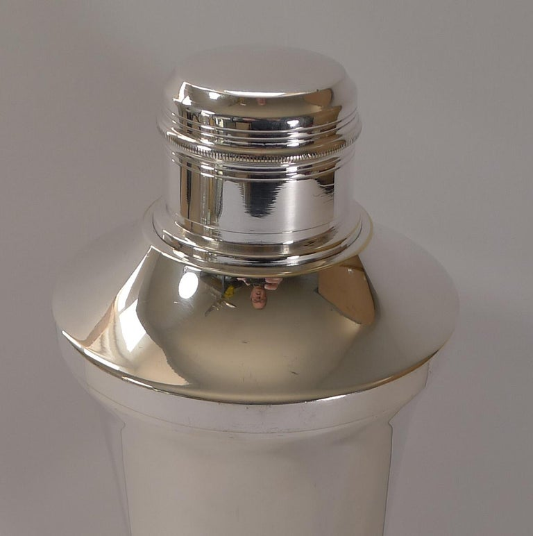 A very smart Art Deco cocktail shaker, French in origin and fully signed by the silversmith on the underside as per the photographs.  Just back from our silversmith's workshop where it has been professionally cleaned and polished, restoring it to