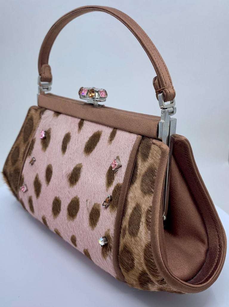 Very stylish and fun, couture designer, Judith Leiber, pony hair leopard print evening purse with hand set jeweled accents, coco brown satin piped trim and matching handle. Purse is lined in a coco brown satin and features a fancy multi colored