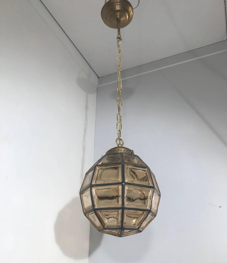 Timeless and small size midcentury pendant by Glashütte Limburg.   This rare ceiling lamp from the midcentury era could be the perfect lighting solution for an entrance or any other small living space. This facetted-globe design is a rare sight and