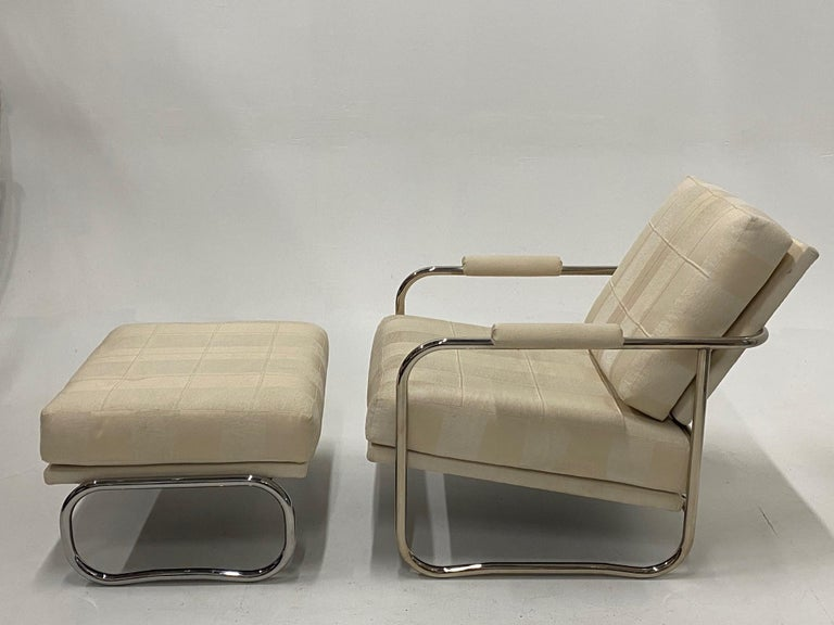 A cool Mid-Century Modern club chair and ottoman having chrome frames and neutral beige on beige striped upholstery.