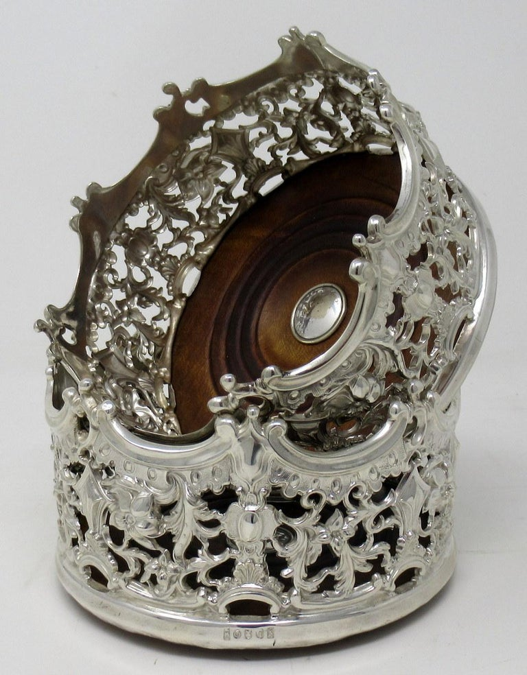 An absolutely stunning identical pair of Italian Rococo style silver plated bottler or wine coaster of exceptional quality and unusually heavy gauge.  Third quarter of the 19th century.   Each with stylish pierced circular body and highly ornate