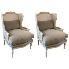 Stylish Pair of Louis XVI Style Painted Walnut and Cane Wing Chairs