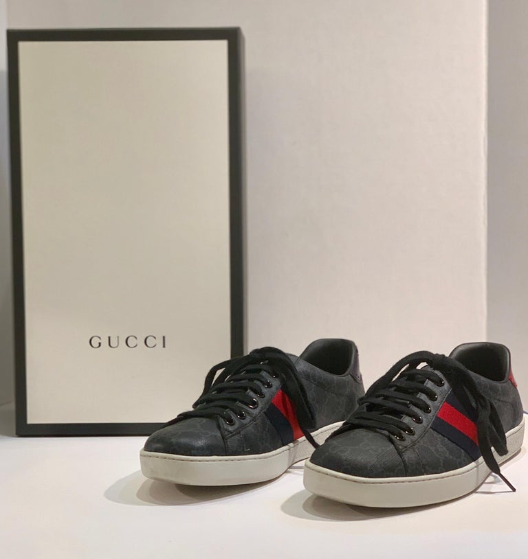 """GUCCI Ace GG Supreme Sneakers are a men's size 7 or a women's size 9 shoe, described on the GUCCI website as, """"The retro inspired design of the Ace sneaker is crafted in GG Supreme canvas in black and grey. First used in the 1970s, the GG logo was"""