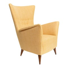 Stylish Scandinavian Upholstered Wing Back Lounge Chair in Gold Fabric