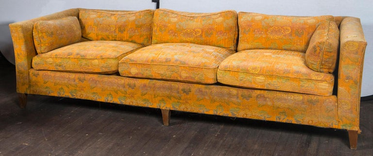 Large fine quality Classic tuxedo style sofa, possibly by Baker. Ready for  reupholstery. Three loose seat cushions, three loose back cushions, two side arm cushions. Timeless design with flared chinoiserie style arms.