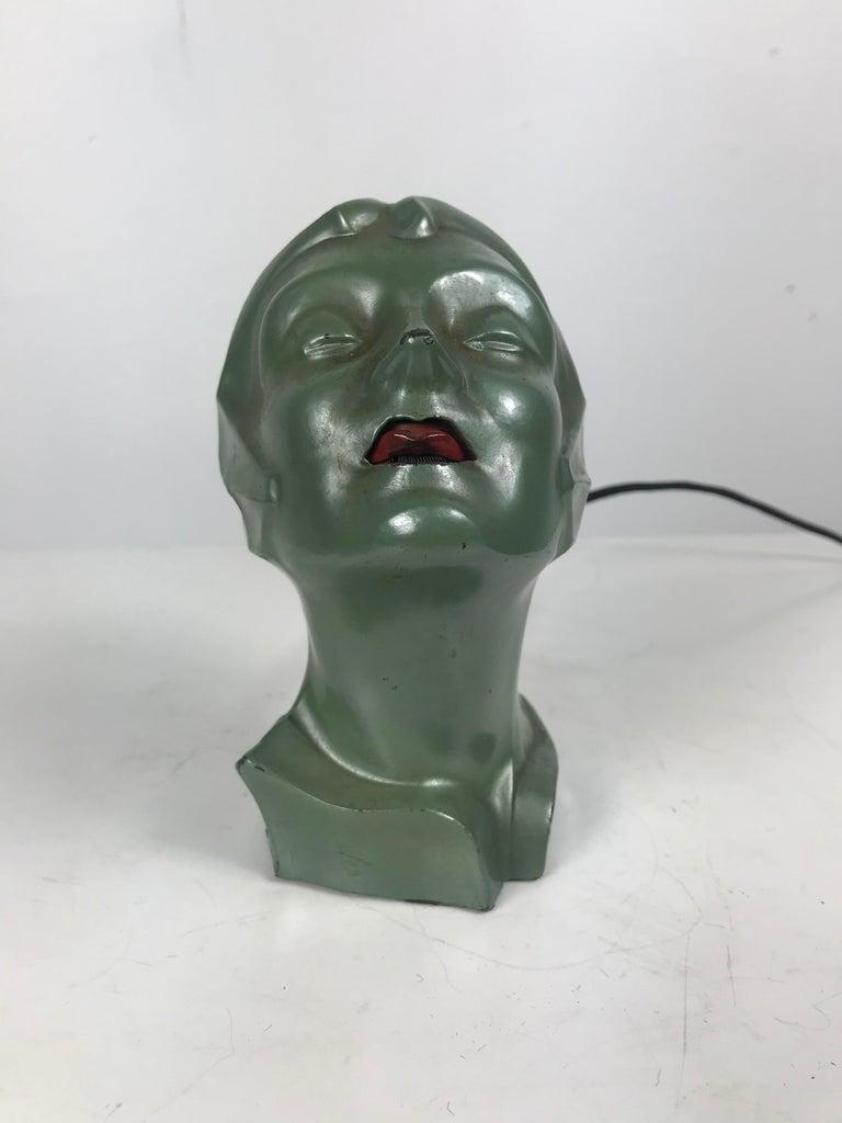 American Stylized 1930s Art Deco Women's Head Electric Cigarette Lighter by Arturo Levi For Sale
