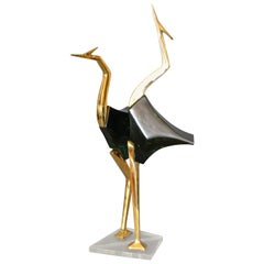 Stylized Brass and Wood Crane Sculptures on Lucite Base, a Pair