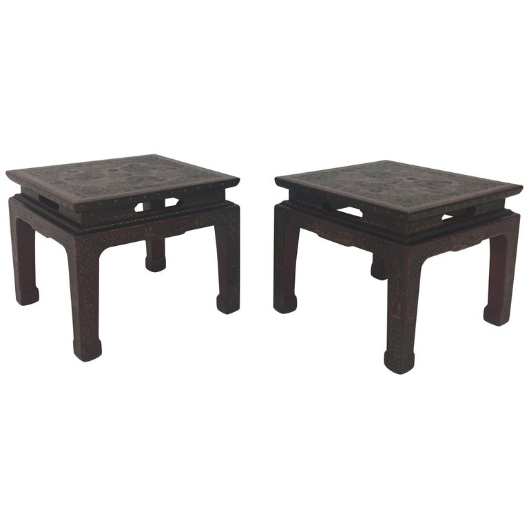 A gorgeous textured encised gesso over wood pair of end or side tables in a deep burgundy with intricate floral and geometric decoration and stunning Chinese sculpted legs.