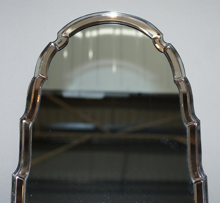 We are delighted to offer for sale this stunning and exceptionally rare circa 1930s Art Deco peach glass Venetian decor mirror with beveled edge frame and curved steeple top   A very good looking well made and decorative wall mirror, these are