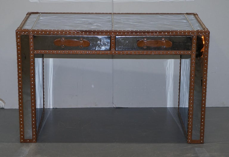 We are delighted to offer for sale this lovely Andrew Martin chrome and leather luggage Military Campaign style desk  A very good looking well made and decorative writing table. The frame is polished chrome and has a mirror finish as do all the
