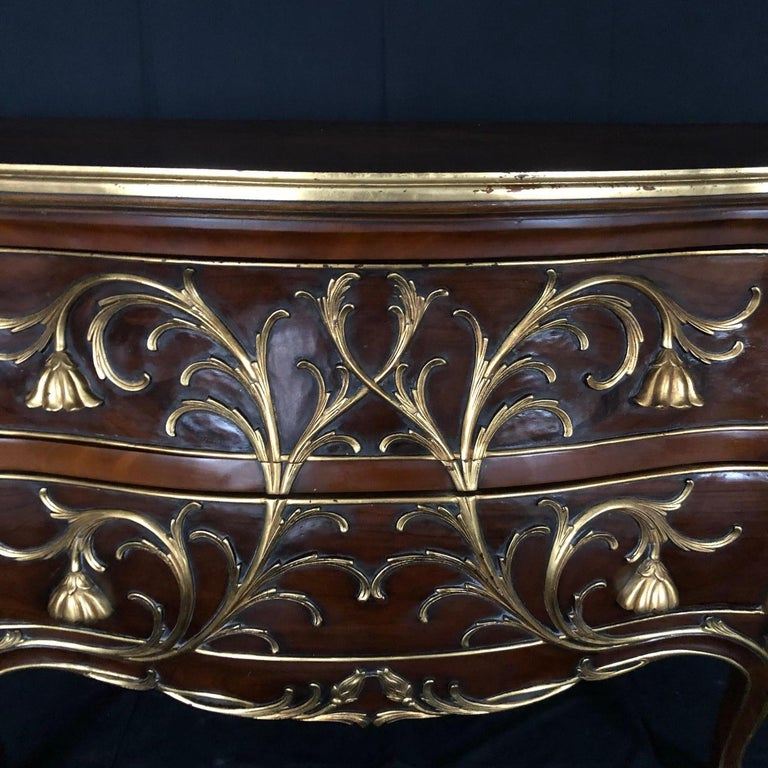 French Sublime Louis XV Serpentine Chest or Commode with Rare Gold Floral Details