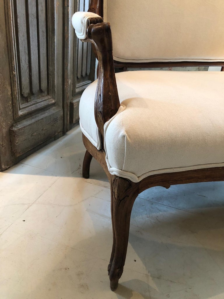 Early 19th Century Sublimely Elegant Early French Carved Wood Sofa with New Upholstery For Sale