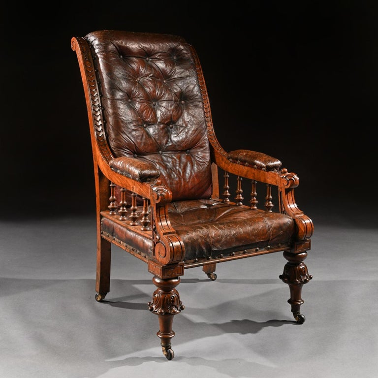 Of grand proportions a 19th century oak armchair retaining its original Moroccan leather upholstery.  English circa 1880.  Standing almost 4 feet tall this imposing chair is in wonderful original condition. Having a scrolled leather deep