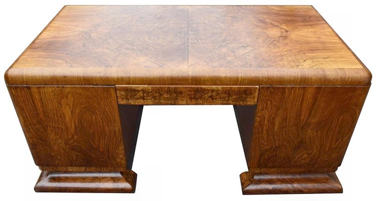 Superb 1930s Art Deco desk, European made from possibly Belgium or French. We sourced from a private residence in London, England who have lovely looked after this piece since the 1940s. Very generous storage on this desk with four paper tray