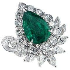 Subtle 18 Karat White Gold, Diamond and Emerald Ring