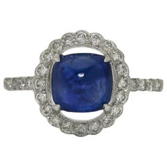 Sugarloaf Cabochon Blue Sapphire Halo Diamond White Gold Target Engagement Ring