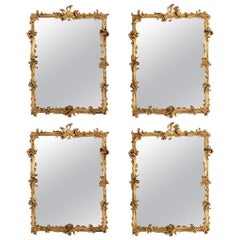 Suite of 4 Carved and Gilded Wooden Mirrors