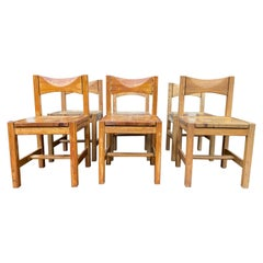 Suite of 6 Chairs and a Bench by Ilmari Tapiovaara