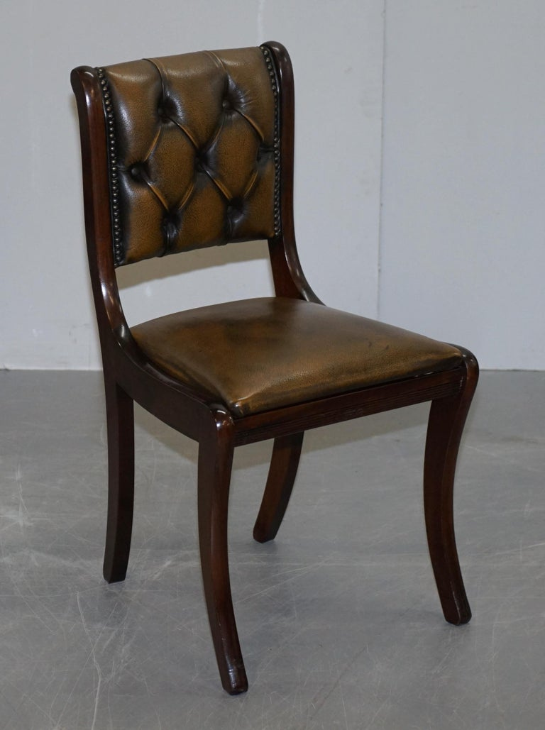 We are delighted to offer for sale this lovely suite of four petrol brown coloured Chesterfield dining chairs with Mahogany frames   A very good looking and decorative set of chairs, the colour is a petrol brown which has a slight green tinge to