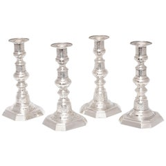 Suite of Four American Colonial Style Sterling Silver Candlesticks
