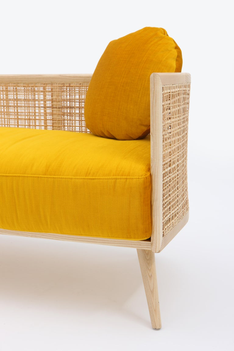 The Summerland sofa is crafted from solid ashwood with a textured straw weave back. A plush upholstered seat provides a high degree of seating comfort.