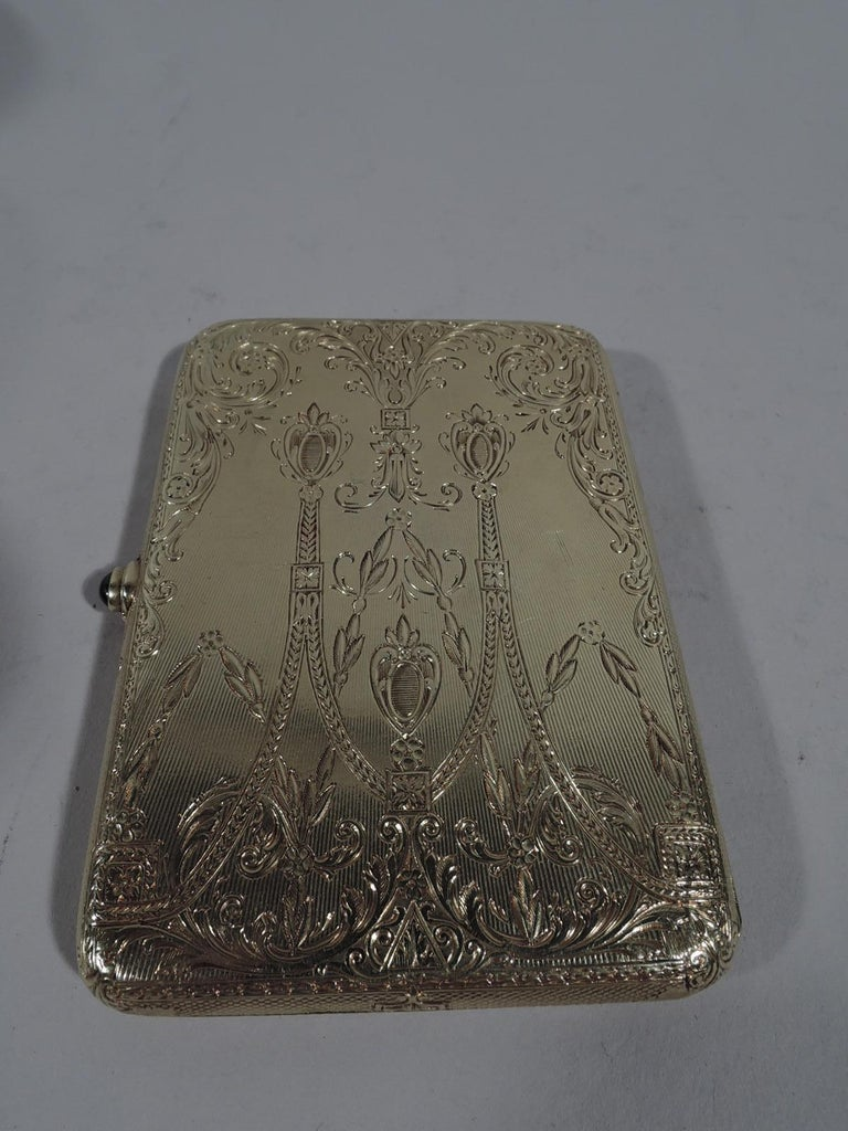 Edwardian 14k yellow gold card case, ca 1910. Rectangular and hinged. On cover are applied swags and leafing scrolls in white gold inset with diamonds and sapphires. On back is engraved same pattern. Very sumptuous and very select. For the exclusive