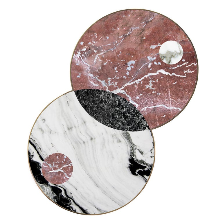 The Lunar Collection introduces the Half Moon dining table, the Sun and Moon coffee table and the Full Moon side table. Discs echoing planetary forms are bisected or overlaid to create surface patterns and structural elements, forming