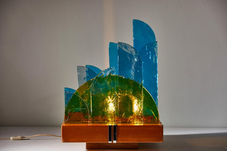 Rare and important Il Sole and la Fuvola which translates to Sun and the cloud table lamp by Luigi Massoni for Itter Elettronica. Designed and manufactured in Italy, 1970. Colored glass, wood, chromed metal inlay. Original cord. Takes two E14