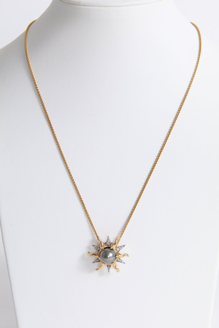 This sun pendant will seduce you by its delicate brightness and its unique design. 18k white and yellow gold. You can buy the 18k yellow gold chain with supplement. White diamonds: 0.23carat Tahitian pearl: 8.5mm French assay mark and signed. Price