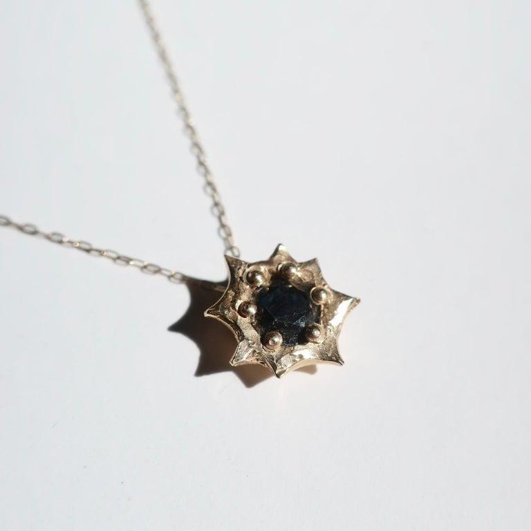Artist Sun Pendant in 14 Karat Yellow Gold with Black Diamond For Sale