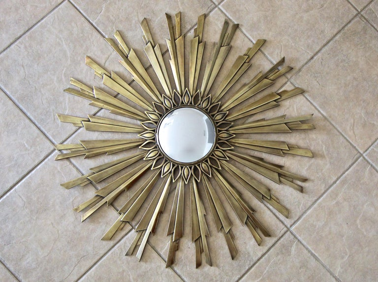 Art Deco sunburst or starburst bronze or brass wall mirror with thick angled