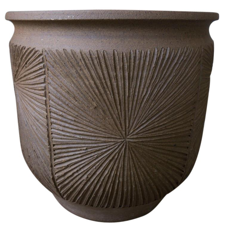 California pottery artists David Cressey and Robert Maxwell formed Earthgender in the 1970s producing a small amount of these amazing vessels ranging in size and design but most with this natural brown color and many with the etched sunburst design.