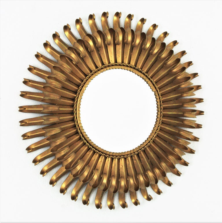 Eye-catching double layered eyelash gilt iron sunburst mirror, France, 1950s The frame is made by a double layer of curved beams in eyelash shape. It will be a nice midcentury addition wherever you place it. Beautiful alone but gorgeous as a part
