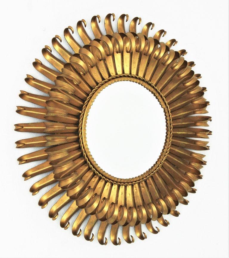 Mid-Century Modern Sunburst Eyelash Mirror in Gilt Wrought Iron For Sale