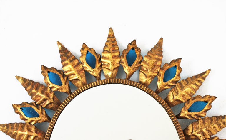 Sunburst Gilt Iron Oval Mirror with Blue Glasses in the Hollywood Regency Style For Sale 5
