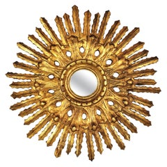 Sunburst Mirror in Carved Gold Leaf Giltwood and Baroque Style, Spain, 1920s