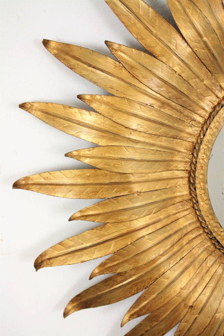 Mid-Century Modern Sunburst Mirror in Gilt Iron with Leafed Frame, Spain, 1950s For Sale