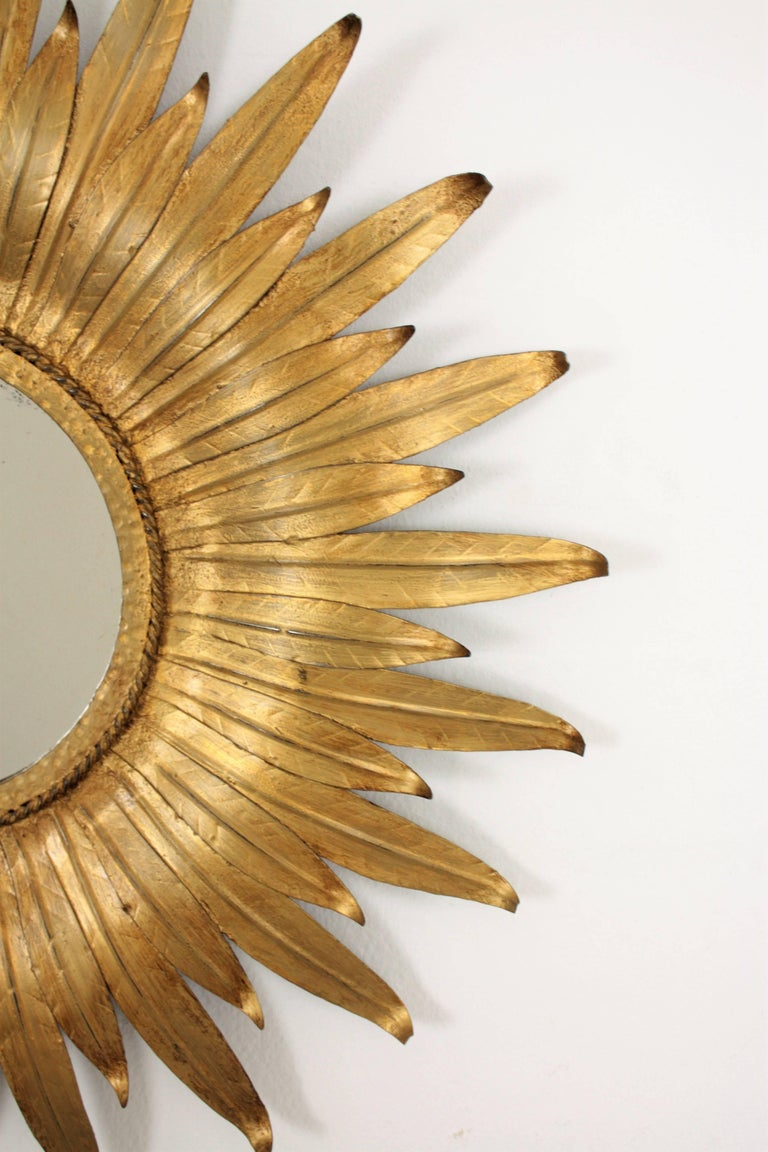 Spanish Sunburst Mirror in Gilt Iron with Leafed Frame, Spain, 1950s For Sale