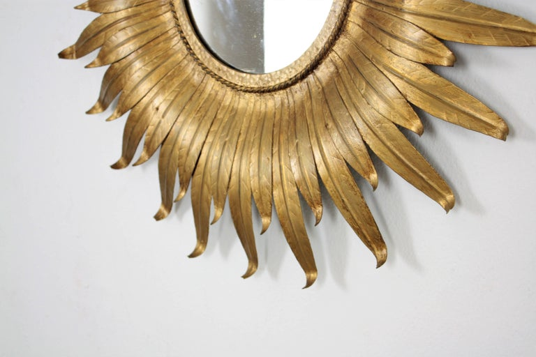 Sunburst Mirror in Gilt Iron with Leafed Frame, Spain, 1950s In Good Condition For Sale In Barcelona, ES