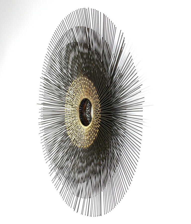 Artistmade sunburst mirror or wall sculpture, in the manner of C. Jere, American, circa 1970s. The sunburst measures 30