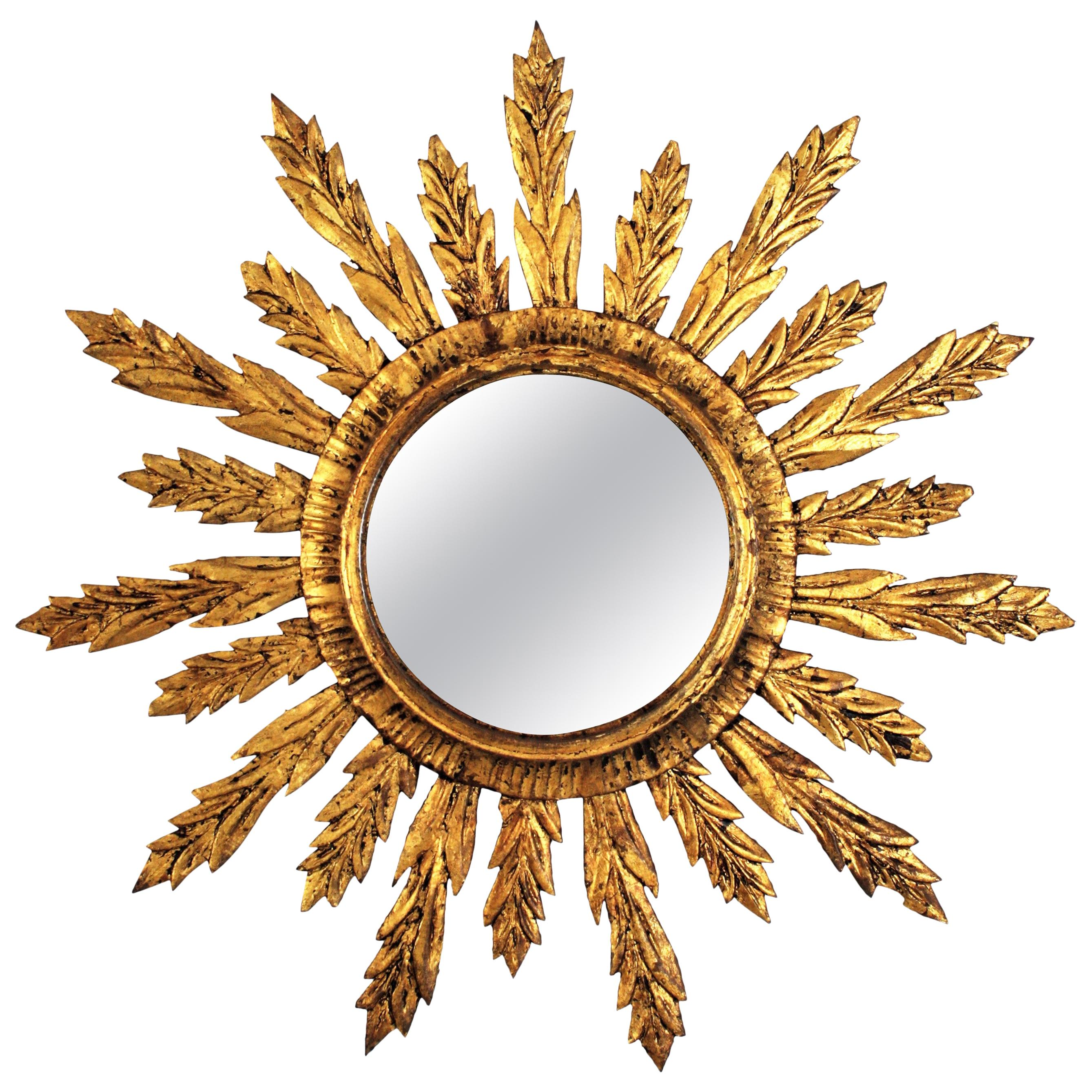 Sunburst Mirror with Leafed Frame in Carved Giltwood
