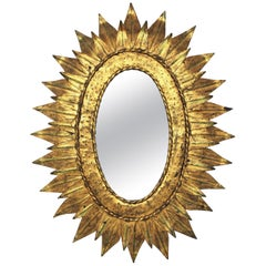 Sunburst Oval Mirror in Gilt Metal with Double Leafed Frame, France, 1950s