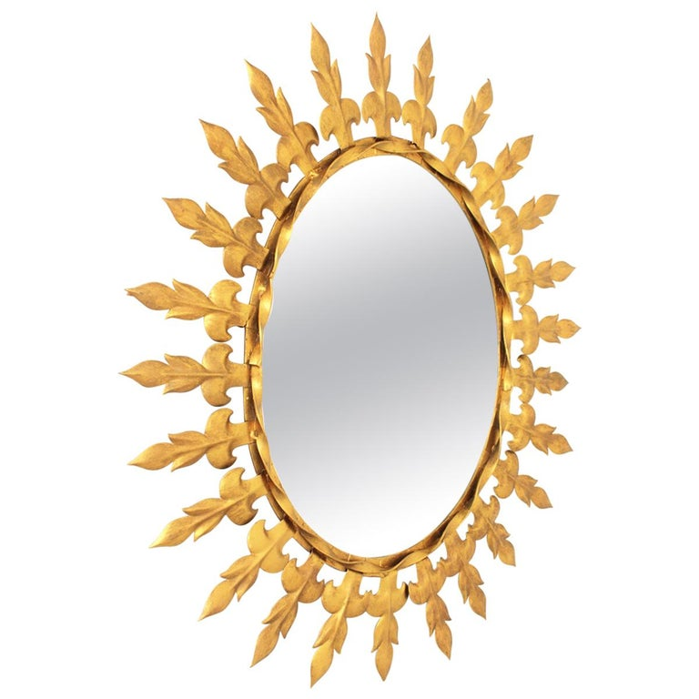 Sunburst Oval Wall Mirror with Fleur de Lys Frame in Gilt Iron For Sale